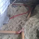 Røret bugter sig i sandet