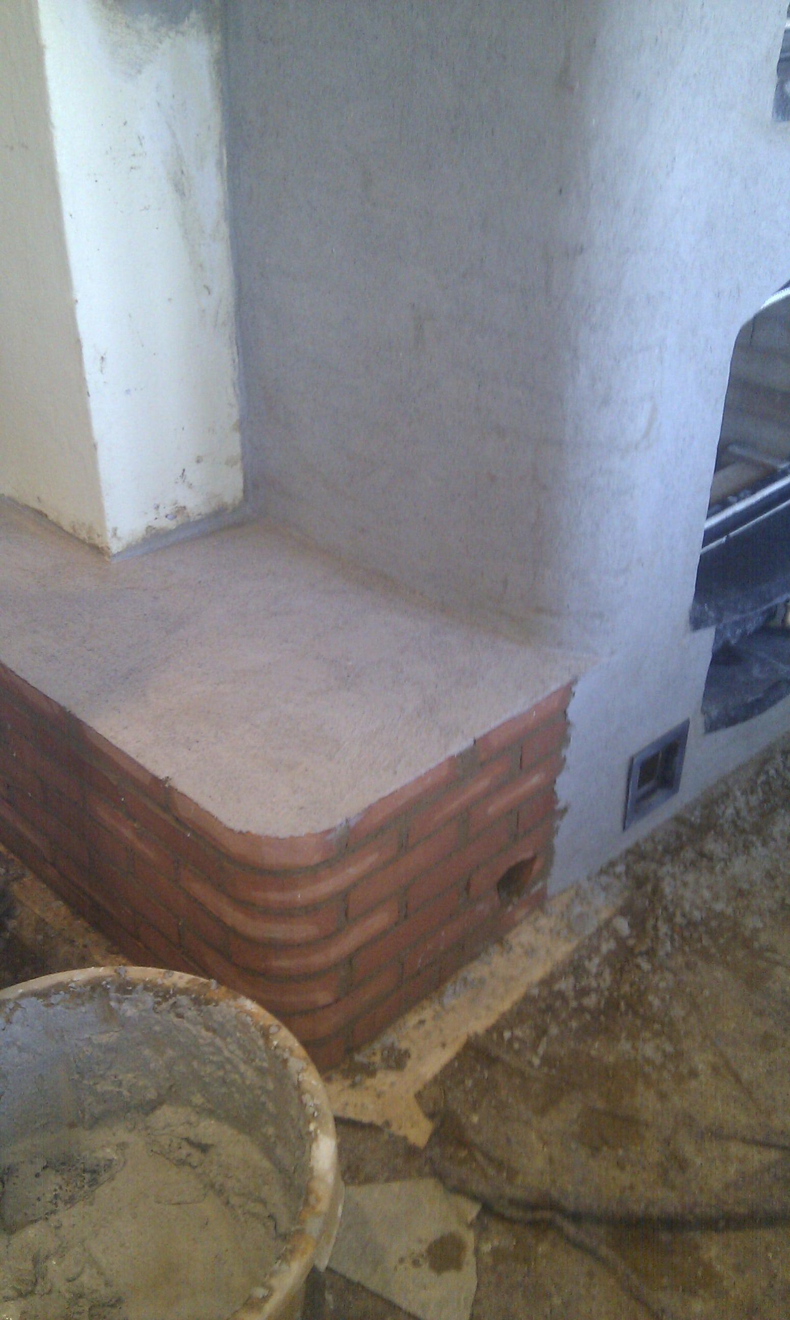 Pudsning af masseovnens varmebænk